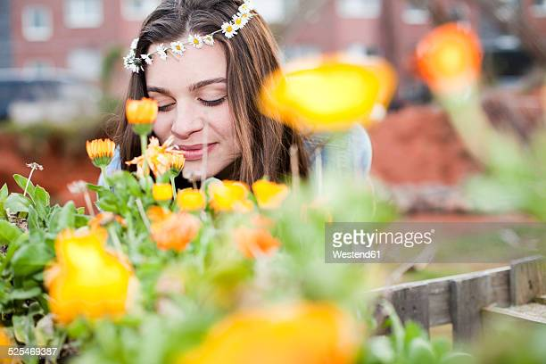 Portrait of smiling young woman enjoying flowers