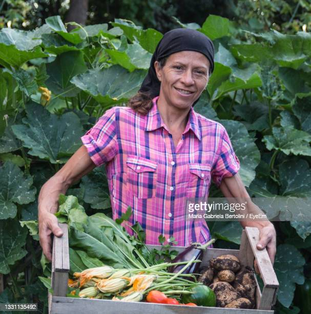 portrait of smiling young woman holding food - south america stock pictures, royalty-free photos & images