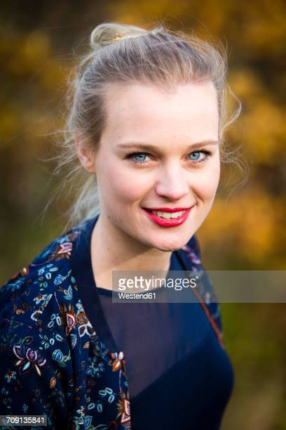 Portrait of smiling young woman in autumn