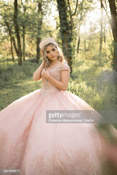 portrait of smiling young woman in forest - strapless dress stock pictures, royalty-free photos & images