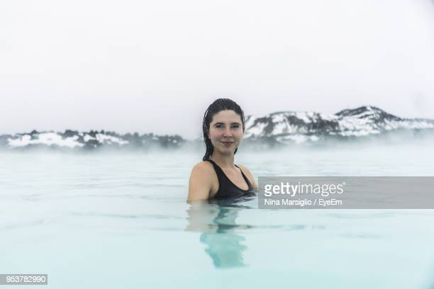 portrait of smiling young woman in hot spring - blue lagoon iceland stock pictures, royalty-free photos & images