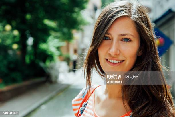 Portrait of smiling young woman in the city