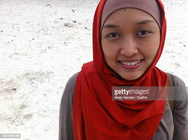 Portrait Of Smiling Young Woman In Traditional Cloths