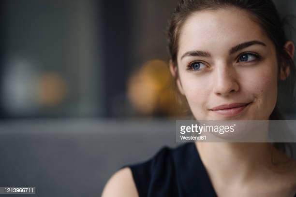 portrait of smiling young woman looking at distance - young women stock pictures, royalty-free photos & images