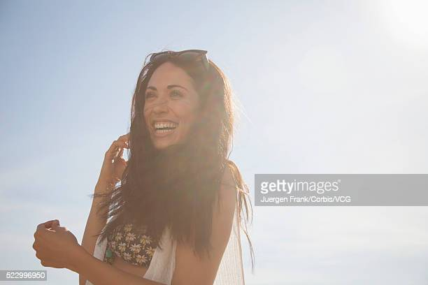 portrait of smiling young woman on sunny day - vcg stock pictures, royalty-free photos & images