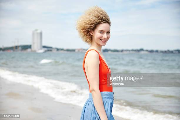 Portrait of smiling young woman on the beach