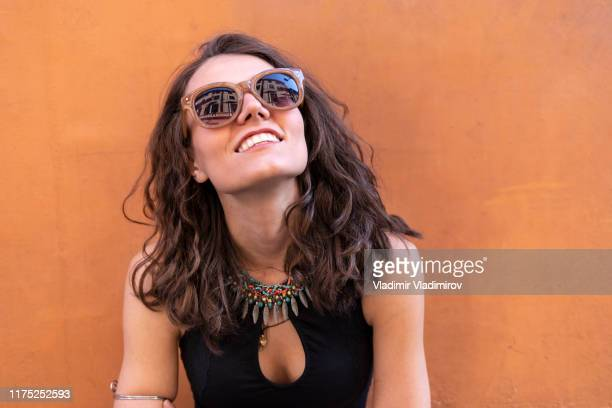portrait of smiling young woman - sunglasses stock pictures, royalty-free photos & images