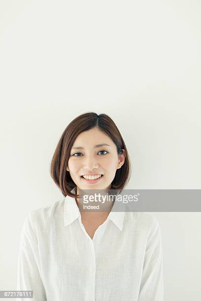 portrait of smiling young woman - waist up stock pictures, royalty-free photos & images