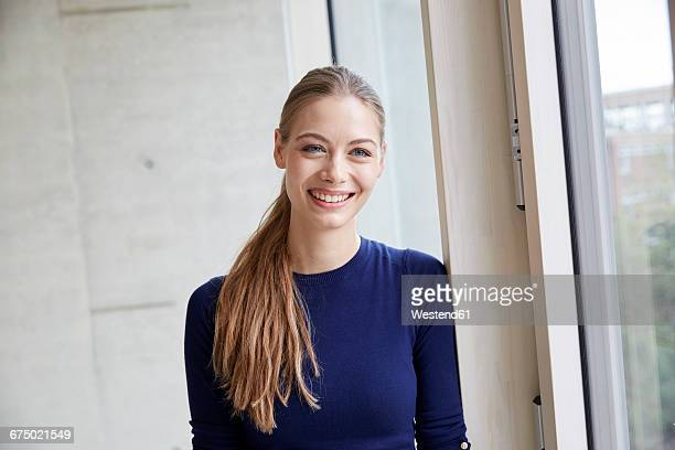 portrait of smiling young woman - ponytail stock pictures, royalty-free photos & images