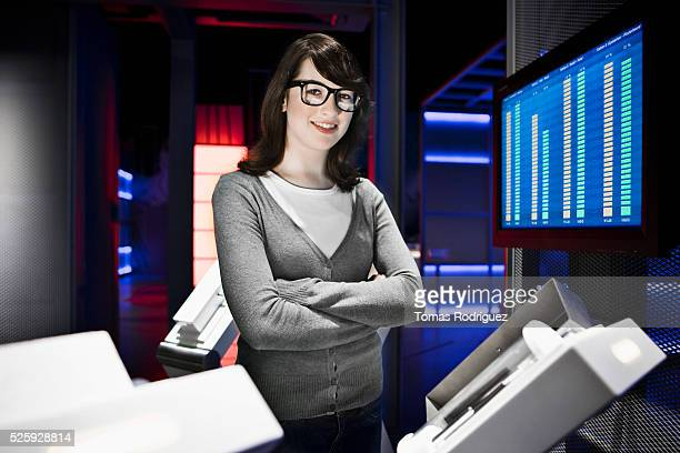 Portrait of smiling young woman standing in laboratory