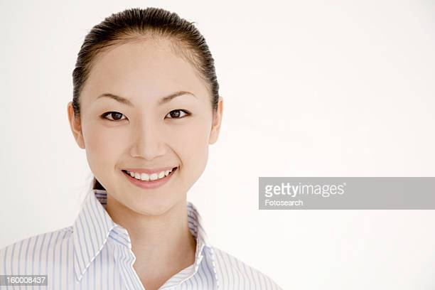 Portrait of smiling young woman wearing a collared shirt