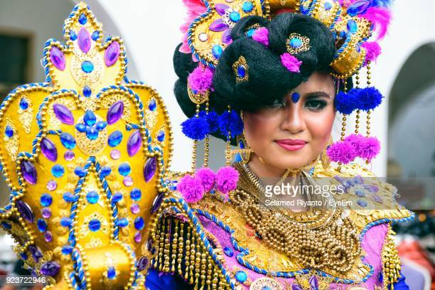 Portrait Of Smiling Young Woman Wearing Costume During Carnival