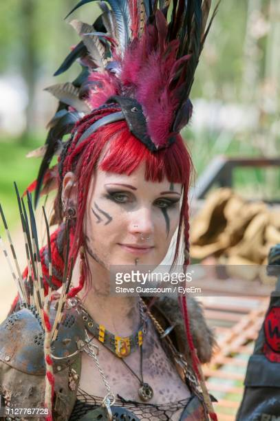 portrait of smiling young woman wearing costume during event - headdress stock pictures, royalty-free photos & images