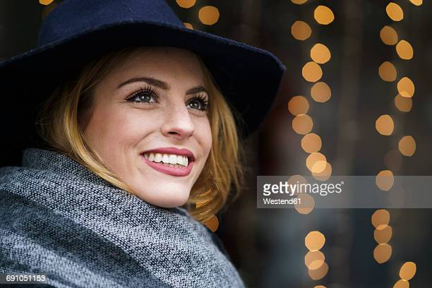 Portrait of smiling young woman wearing hat and scarf