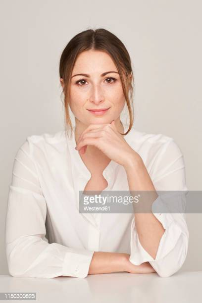 portrait of smiling young woman wearing white blouse - 白いシャツ ストックフォトと画像