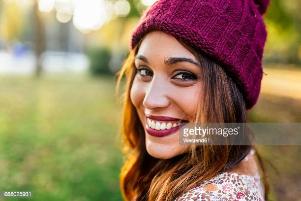 Portrait of smiling young woman wearing wooly hat
