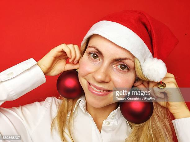 Portrait Of Smiling Young Woman With Christmas Decorations
