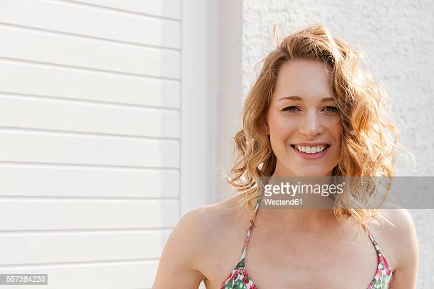 portrait of smiling young woman with curly hair - spaghetti straps stock pictures, royalty-free photos & images