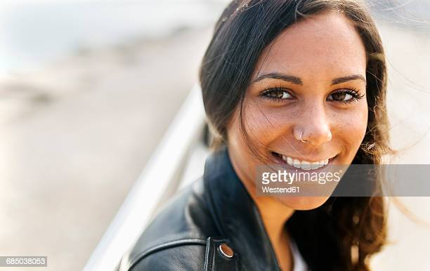 portrait of smiling young woman with freckles and nose piercing - nose piercing stock pictures, royalty-free photos & images