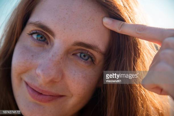 portrait of smiling young woman with freckles - human head stock pictures, royalty-free photos & images