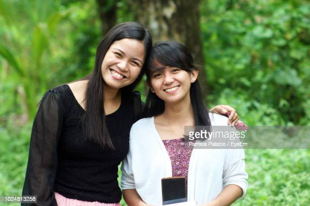 Portrait Of Smiling Young Woman With Friend