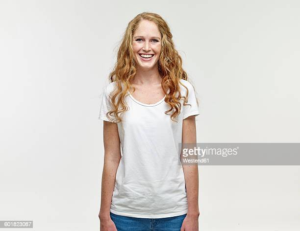 portrait of smiling young woman with long blond hair - europese etniciteit stockfoto's en -beelden