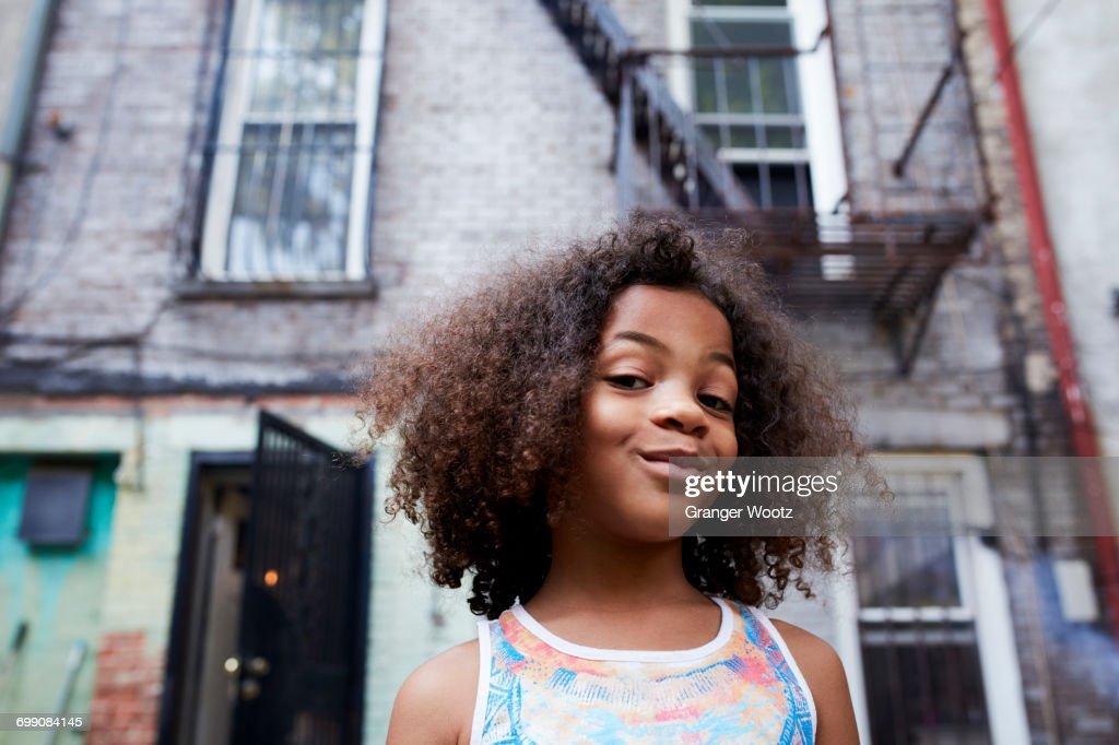 Portrait of smirking Mixed Race girl : Stock Photo