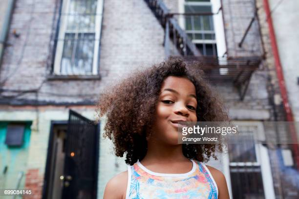 portrait of smirking mixed race girl - attitude stock pictures, royalty-free photos & images