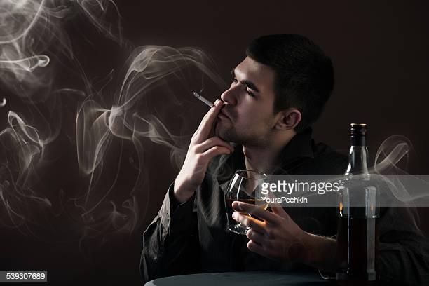 Portrait of smoking alcoholic