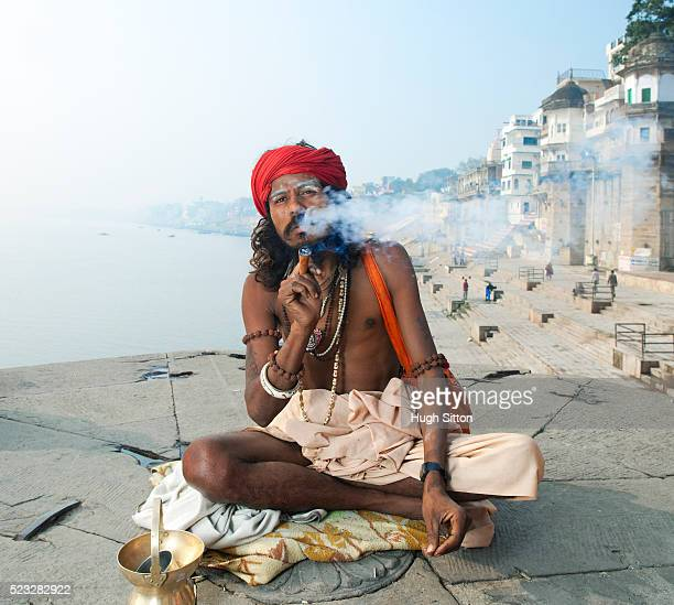 portrait of smoking sadhu - hugh sitton stock pictures, royalty-free photos & images