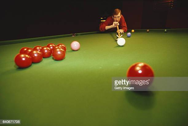 Portrait of snooker world champion Steve Davis of Great Britain as he lines up the cue ball on 1 January 1985 in London, United Kingdom.