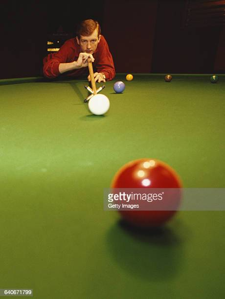 Portrait of snooker world champion Steve Davis of Great Britain as he lines up the cue ball on 1 January 1985 in London United Kingdom
