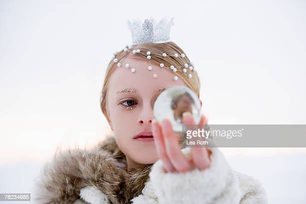 portrait of snow queen holding crystal ball