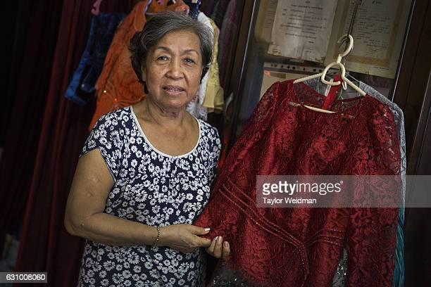 A portrait of Sok Kha taken in her tailor shop