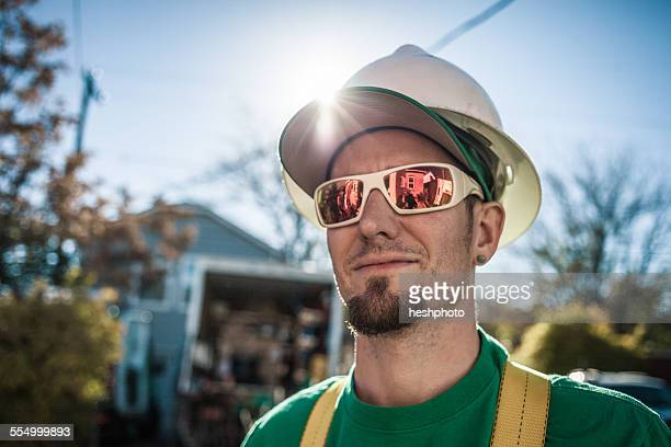 portrait of solar panel installation crew member - heshphoto stock pictures, royalty-free photos & images