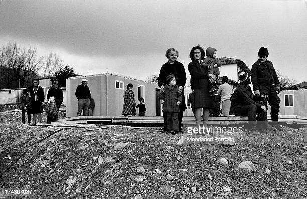 Portrait of some evacuated families of a village near Pordenone after the earthquake of May 6th who are now obliged to live in Canadian prefabricated...