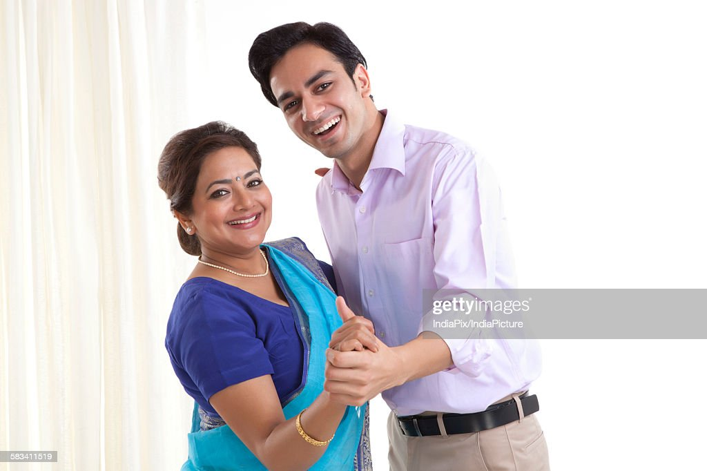 Portrait of son dancing with his mother : Stock Photo