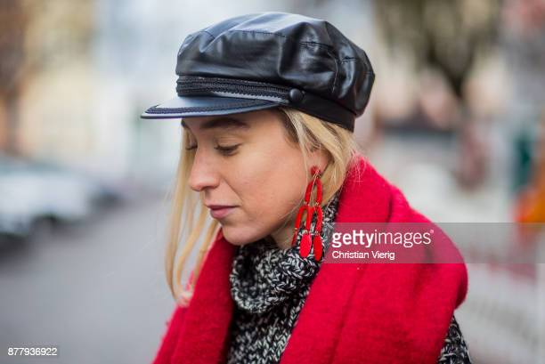 Portrait of Sonia Lyson wearing black leather vintage hat grey knit Zara black gloves Zara red earrings Mango on November 23 2017 in Berlin Germany