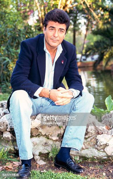 Portrait of Spanish actor Maximo Valverde in jeans and a blazer as he poses outdoors Madrid Spain 1997