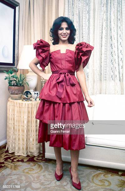 Portrait of Spanish actress Sara Mora as she poses in a cocktail dress Madrid Spain 1981