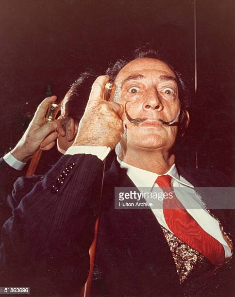 Portrait of Spanish artist Salvador Dali with his cane, 1960s.