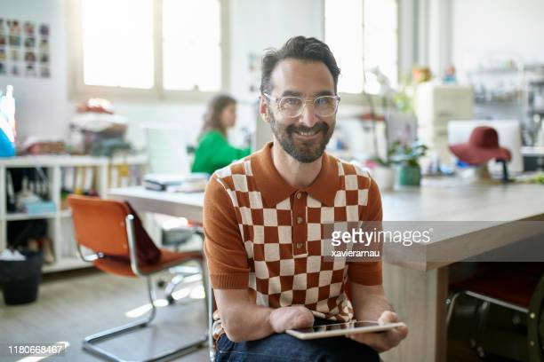 portrait of spanish design professional using digital tablet - physical disability stock pictures, royalty-free photos & images