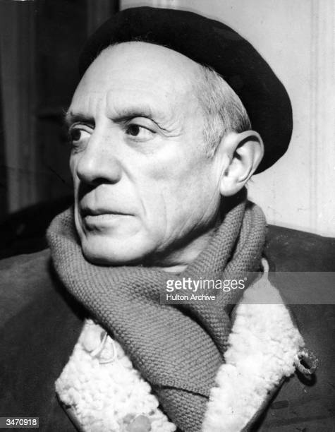Portrait of Spanishborn artist Pablo Picasso in a winter coat scarf and beret 1950s