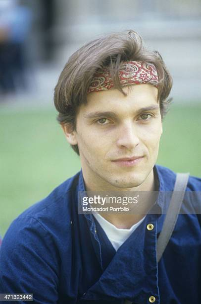 Portrait of Spanishborn Italian singer and TV presenter Miguel Bos wearing a bandana London 1981