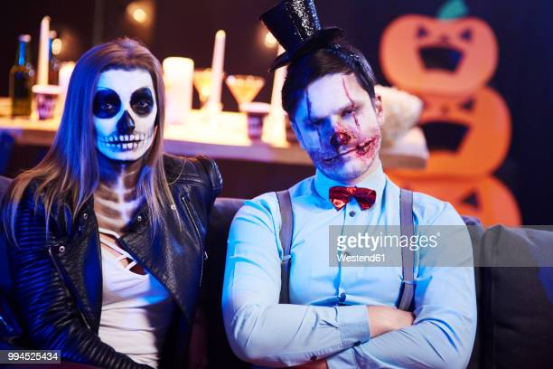 portrait of spooky couple at halloween party - halloween party stock photos and pictures