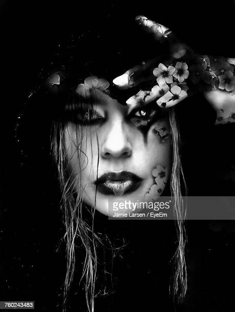 Portrait Of Spooky Woman With Make-Up Against Black Background