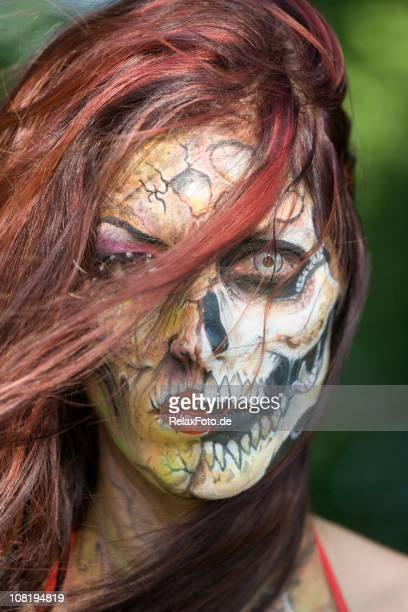 portrait of spooky woman with skull face painting - dyed red hair stock pictures, royalty-free photos & images