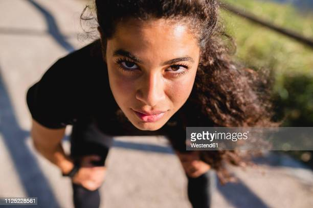 portrait of sportive young woman having a break - extra long stock pictures, royalty-free photos & images
