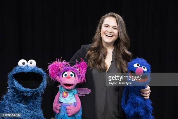 Portrait of Sports Illustrated via Getty Images senior writer and host Charlotte Wilder posing with Cookie Monster, Abby Cadabby, and Grover of...
