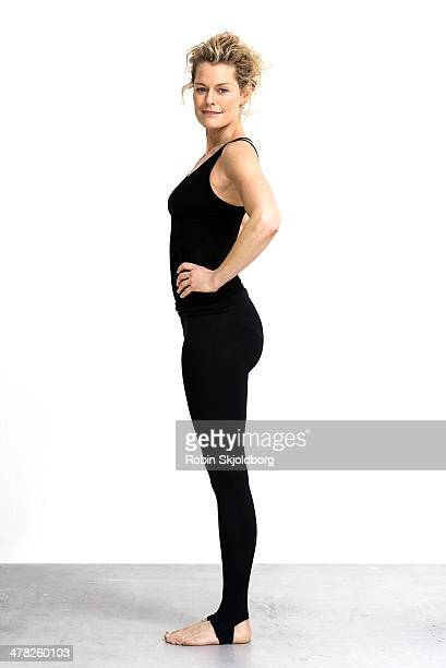 Portrait of sporty woman in tights and bare feet